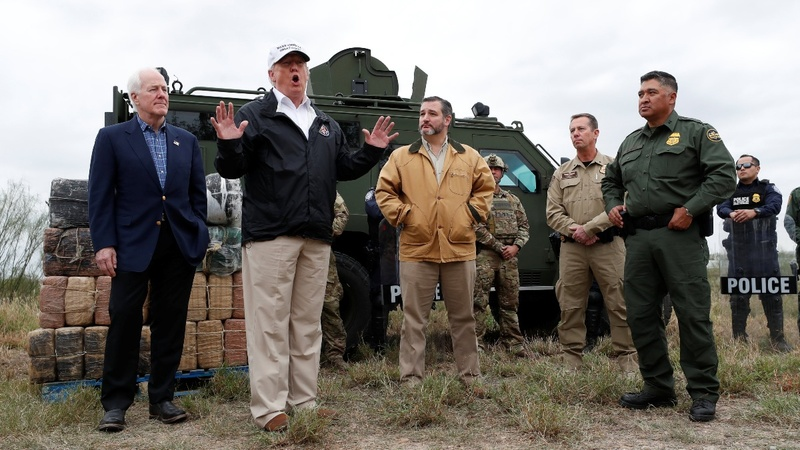 At the border, Trump defends 'medieval' wall