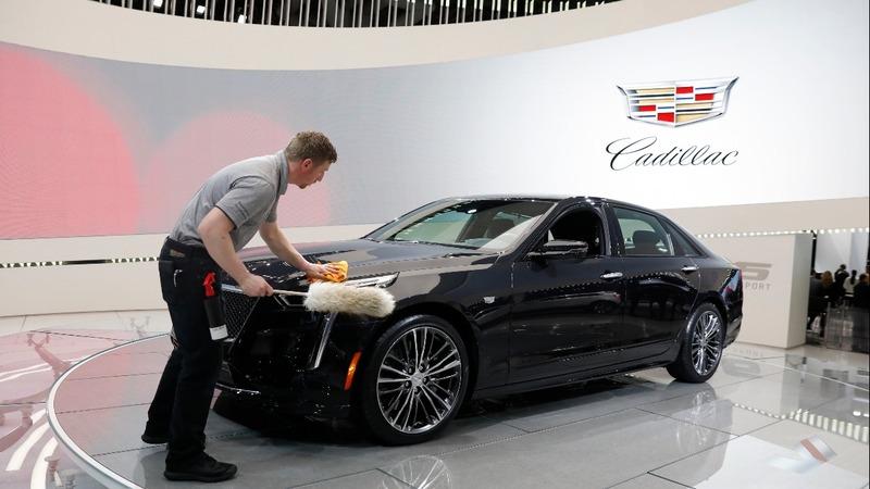 GM surges after raising profit forecast