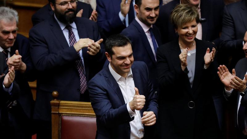 Greek PM narrowly wins confidence vote