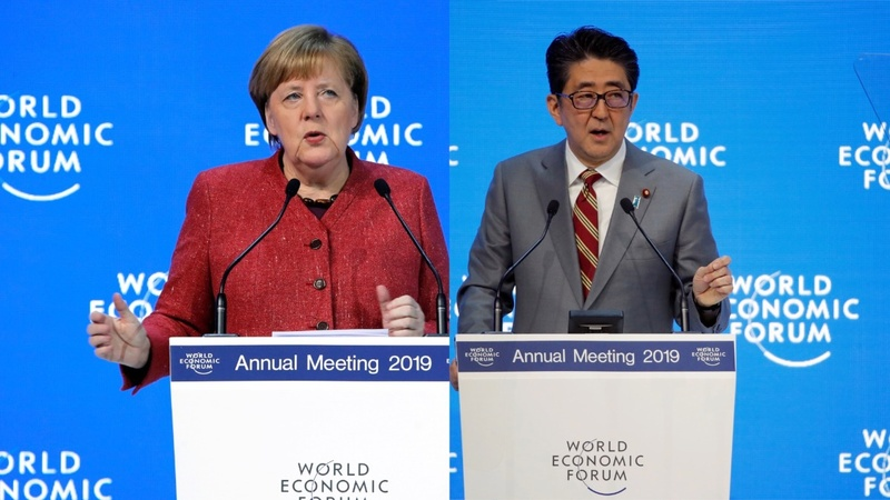 Merkel, Abe preach cooperation to Davos crowd