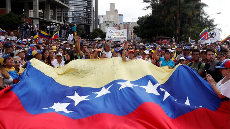 Thousands of Venezuelans march to oust Maduro