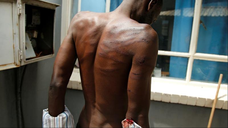 Zimbabwe army blames brutality on impostors
