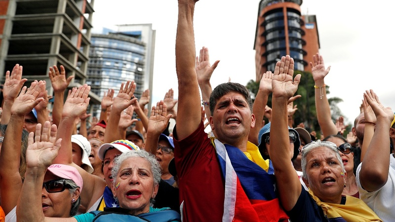Pressure mounts on Maduro as U.S. threatens to cut money