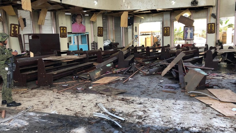 Philippines vows to crush church bomb attackers