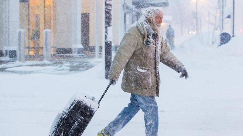 Arctic blast blows record cold across U.S.