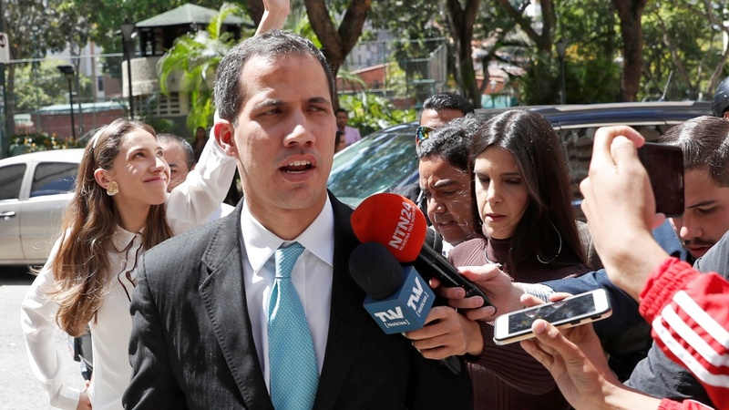 Venezuela's Guaido says police visited his home