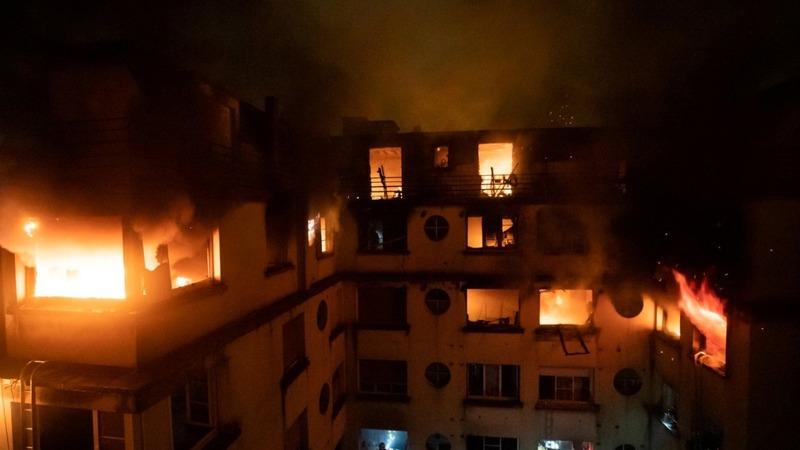 Woman held after deadly Paris blaze