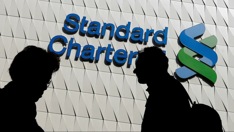 Standard Chartered sets aside $900 mln for fines