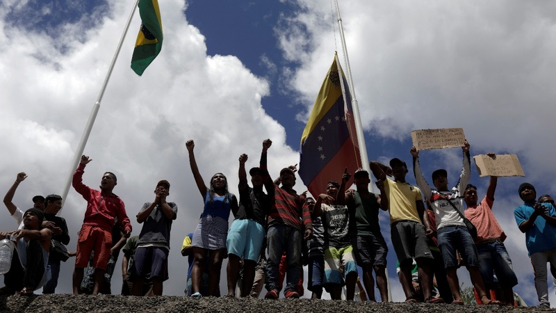 First bloodshed linked to Venezuela aid standoff