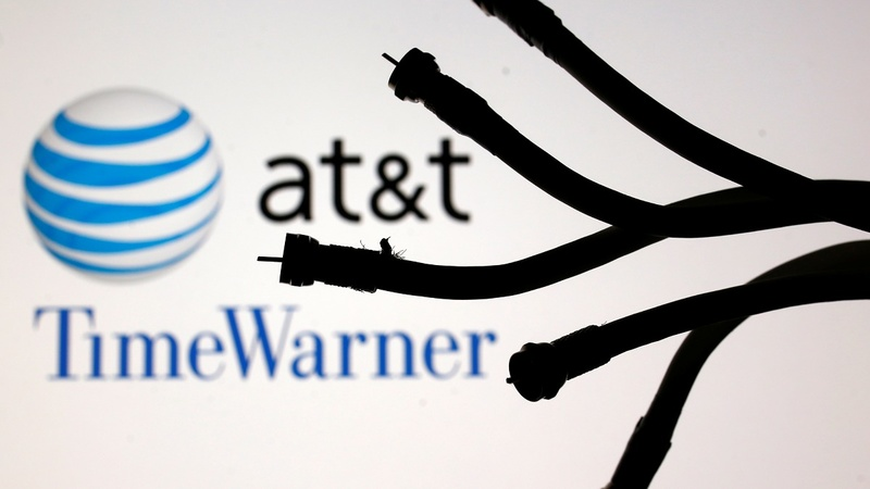 AT&T defeats U.S. in fight to buy Time Warner