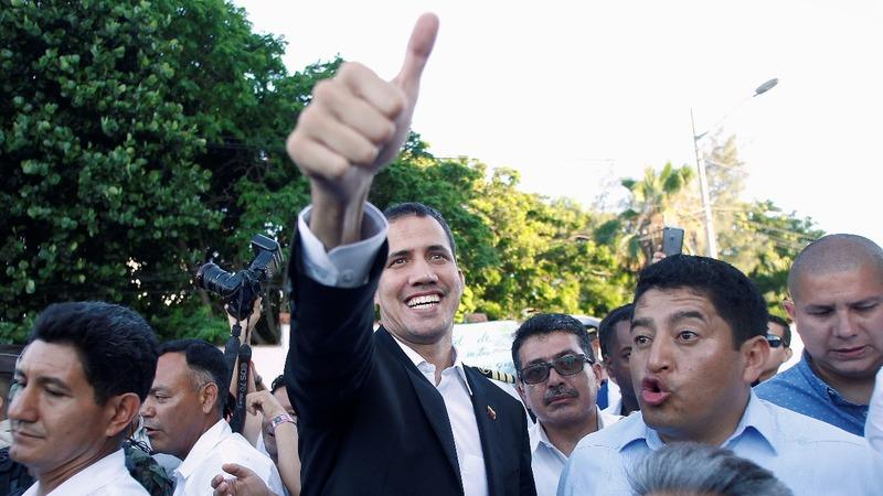 A defiant Guaido returns home to Venezuela
