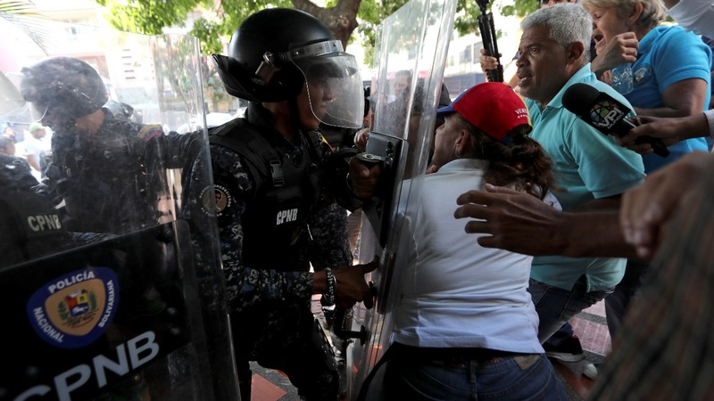 Protesters, police clash in Venezuela blackout