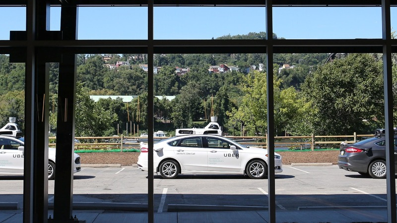 Softbank, Toyota may invest in self-driving Ubers