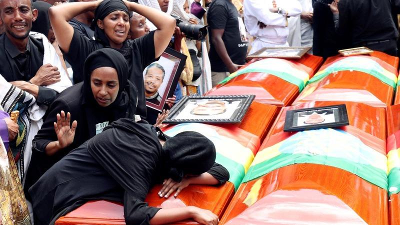 Families symbolically bury plane crash victims