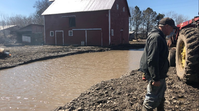 Midwest flooding makes a dent in farmers' wages