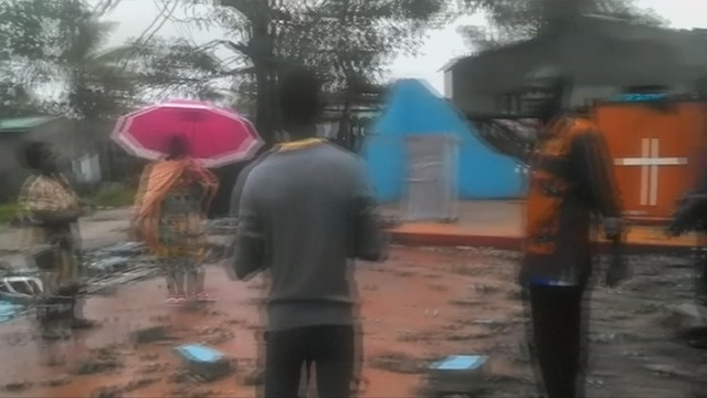 Faithful sing in remains of church hit by Cyclone Idai