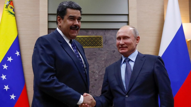 Russia says it sent military officials to Venezuela
