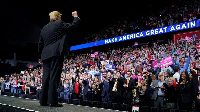 Trump tears into critics at Michigan rally
