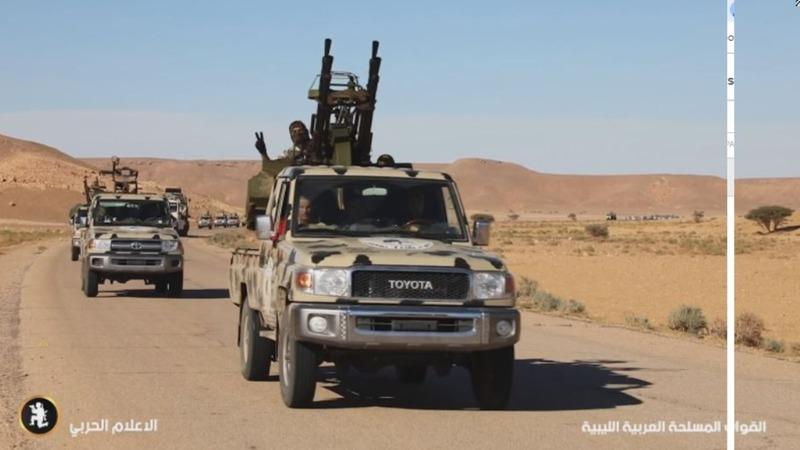 East Libyan troops close on Tripoli, claim airport