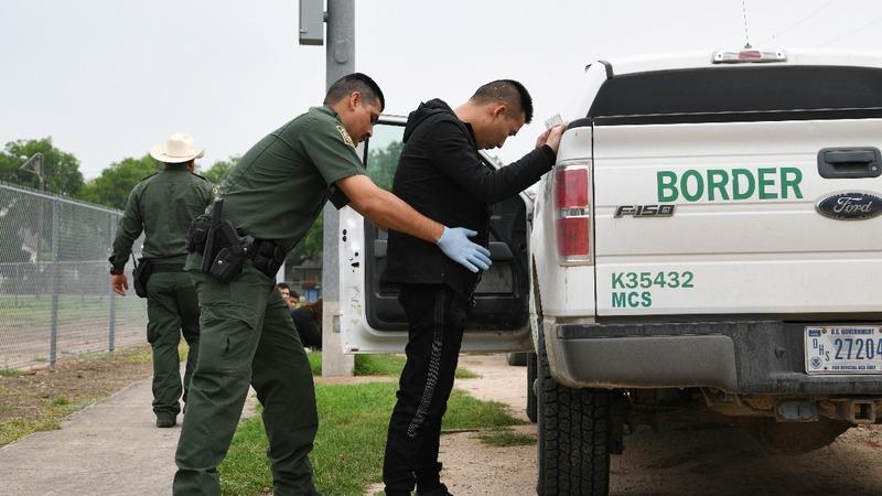 Judge halts policy keeping asylum-seekers in Mexico