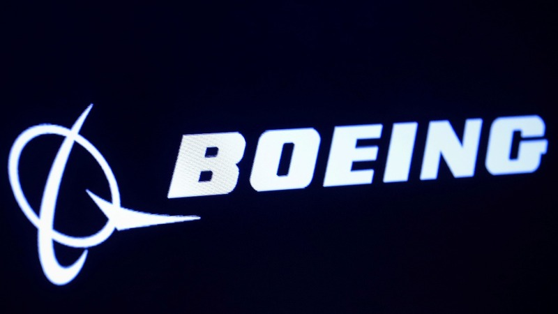 Boeing orders down by almost half