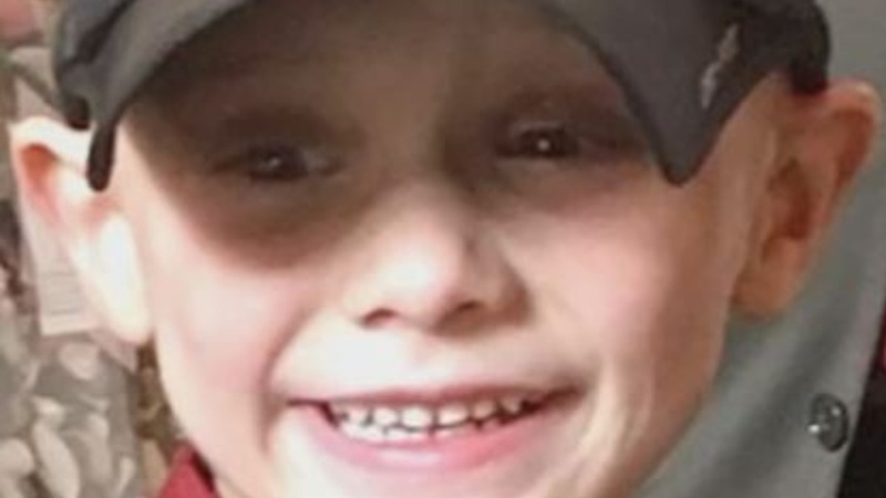 Illinois boy found in grave, parents arrested