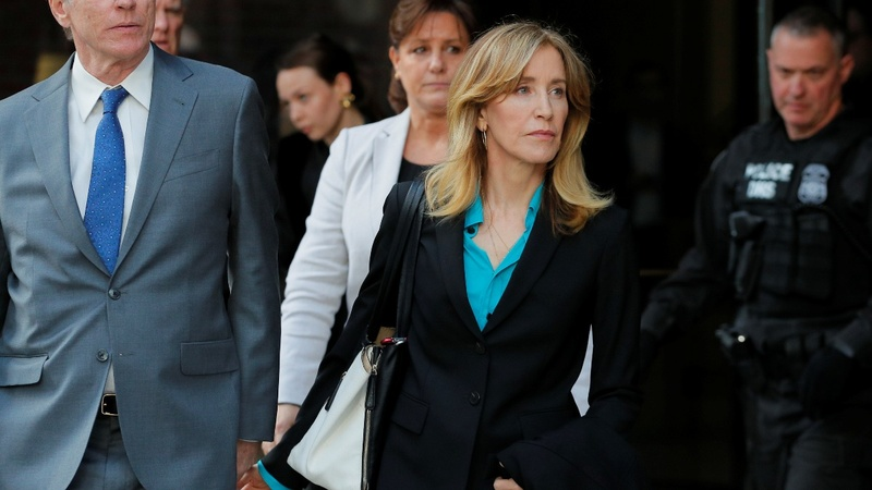Huffman to plead guilty in admissions scandal
