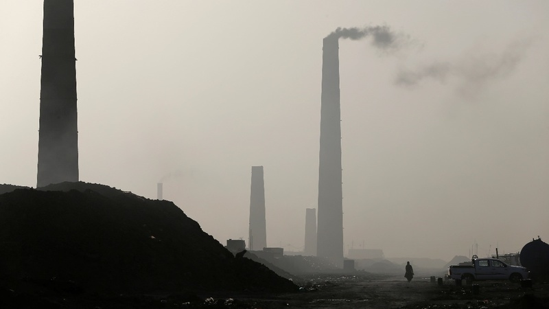Burning trash and factory smoke choke Iraqis