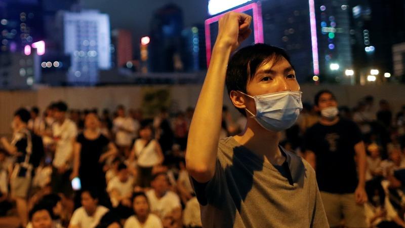 Despite protests, Hong Kong pushes extradition bill