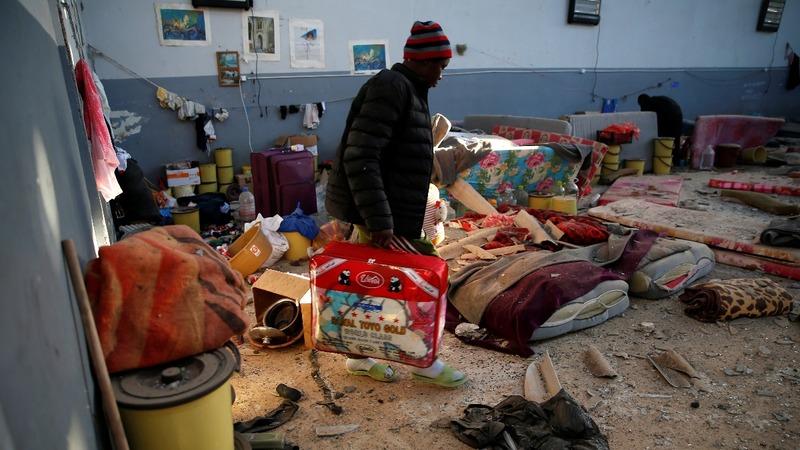 UN: guards shot at migrants fleeing airstrikes