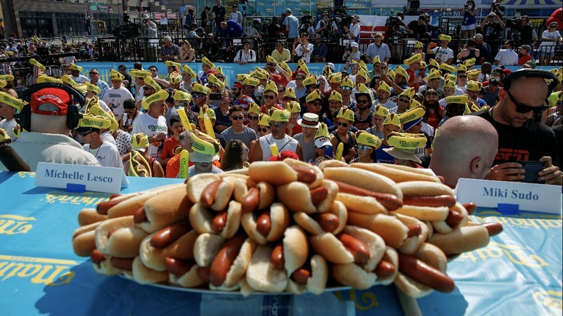 INSIGHT: Chestnut, Sudo defend hot dog eating titles