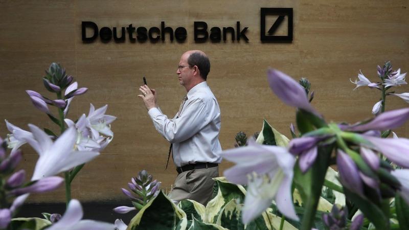 Deutsche Bank shares tumble as deal doubts mount