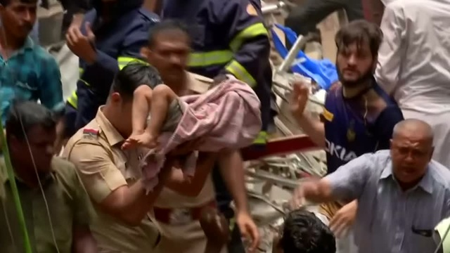 Dozens feared trapped by India building collapse