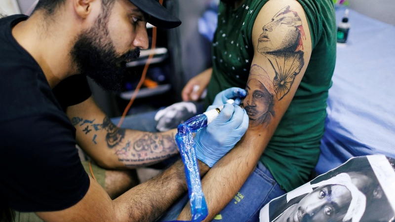 Inspired by U.S., young Iraqis get inked