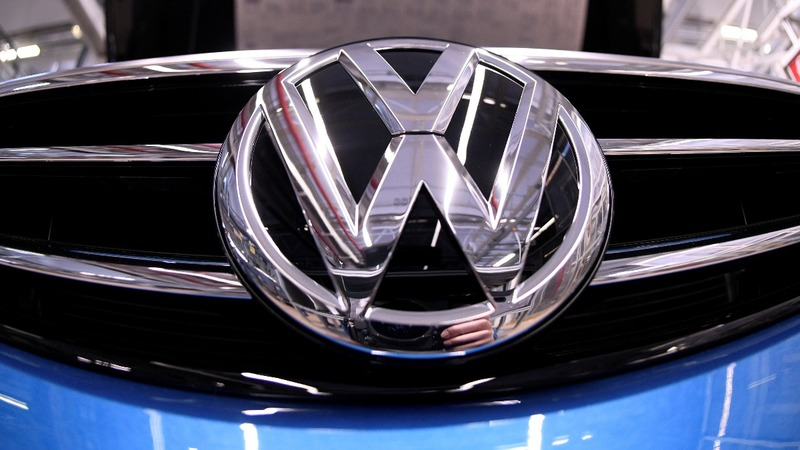 Profits sink at automakers, but VW defies gloom
