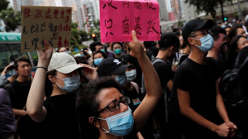 'Riot' charges spark new Hong Kong protests