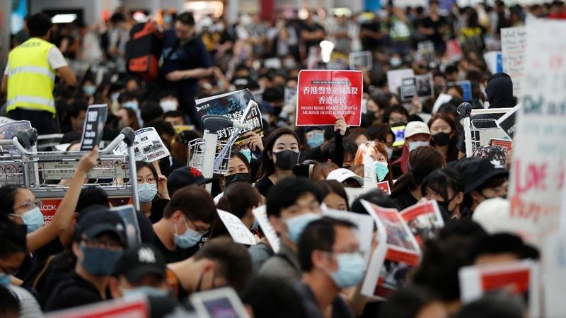 Clashes at Hong Kong airport as turmoil deepens