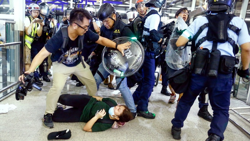 Street clashes resume as Hong Kong airport reopens
