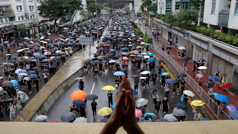 Hong Kongers rally under stormy skies