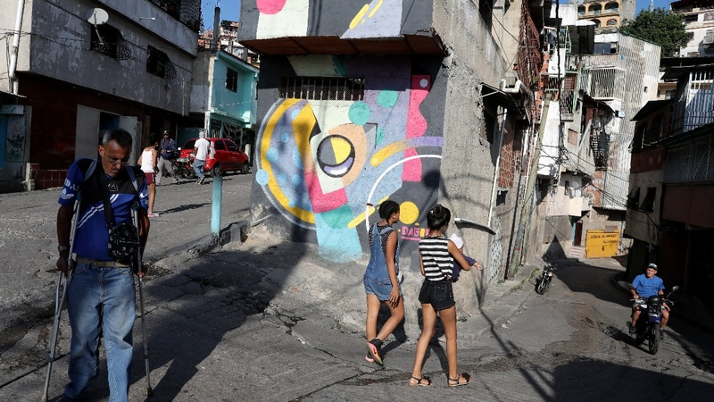 Artists try to change image of violent Caracas slum