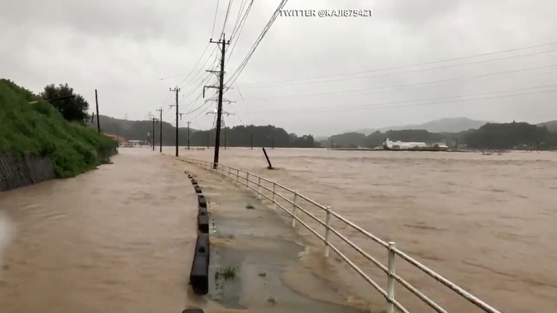 Record rains in Japan cause floods, kill two