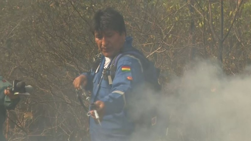 President Evo Morales dons fire suit, fights fires
