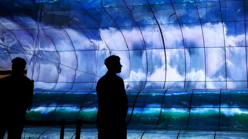 At Europe tech fair, Huawei stays defiant