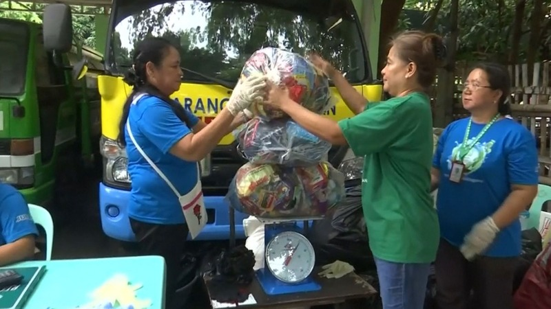 A Philippine village exchanges plastic for rice