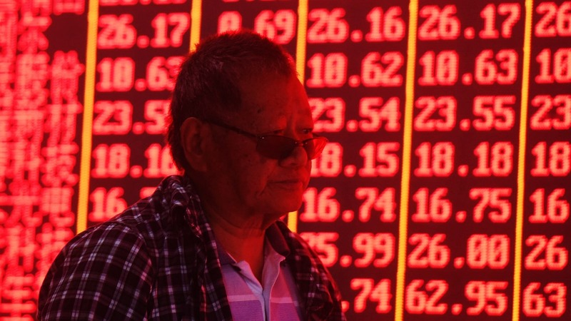 China shares sink on U.S. delisting reports