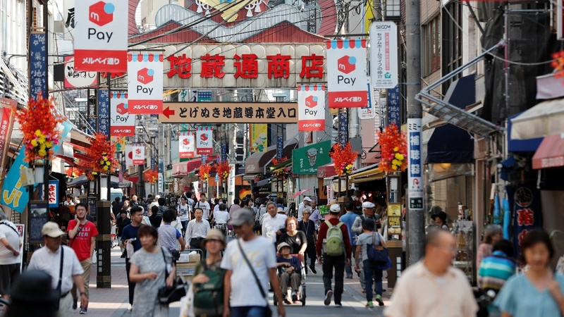 Despite growth worries, Japan hikes taxes