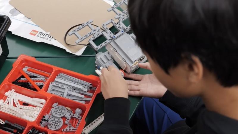 Students build robo-arm for robotics teacher