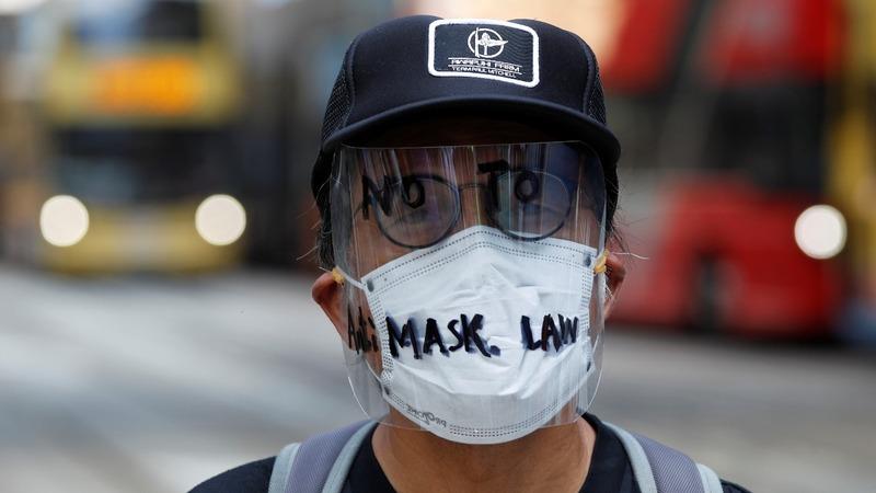 Hong Kong bans face masks at protests
