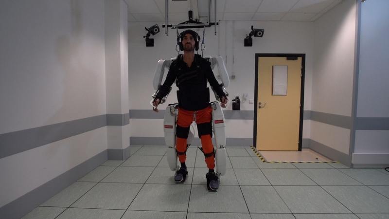 Paralyzed man walks using mind-controlled robot