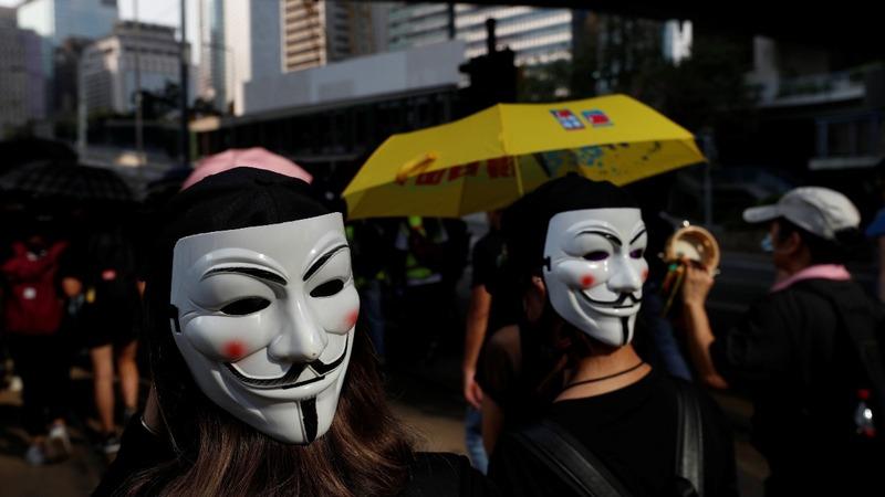 Protesters defy face-mask ban in Hong Kong